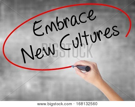 Woman Hand Writing Embrace New Cultures With Black Marker Over Transparent Board