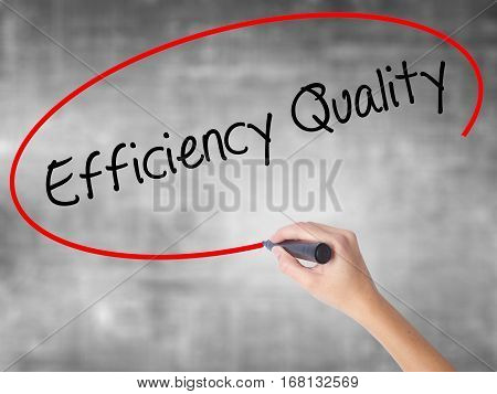 Woman Hand Writing Efficiency Quality  With Black Marker Over Transparent Board.