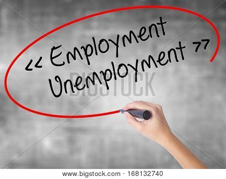 Woman Hand Writing Employment - Unemployment With Black Marker Over Transparent Board.