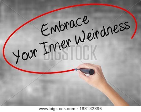 Woman Hand Writing Embrace Your Inner Weirdness  With Black Marker Over Transparent Board