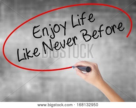 Woman Hand Writing Enjoy Life Like Never Before With Black Marker Over Transparent Board