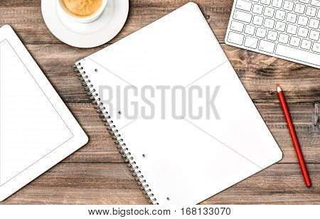 Open book digital tablet pc keyboard and cup of coffee on wooden background. Business plan start up concept. Office workplace