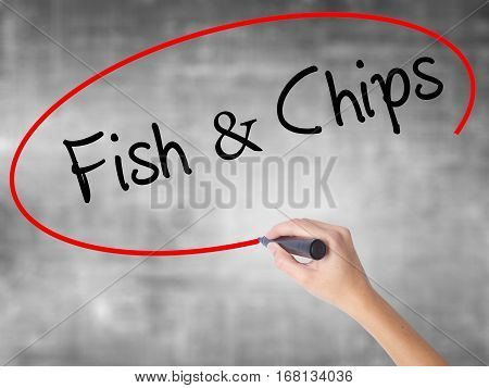 Woman Hand Writing Fish & Chips With Black Marker Over Transparent Board