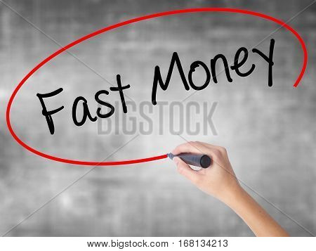 Woman Hand Writing Fast Money  With Black Marker Over Transparent Board