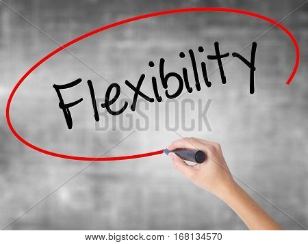 Woman Hand Writing Flexibility With Black Marker Over Transparent Board