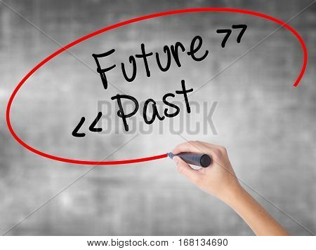 Woman Hand Writing Future - Past With Black Marker Over Transparent Board.