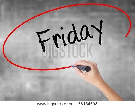 Woman Hand Writing Friday With Black Marker Over Transparent Board
