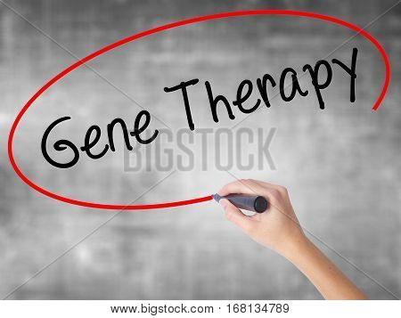 Woman Hand Writing  Gene Therapy  With Black Marker Over Transparent Board