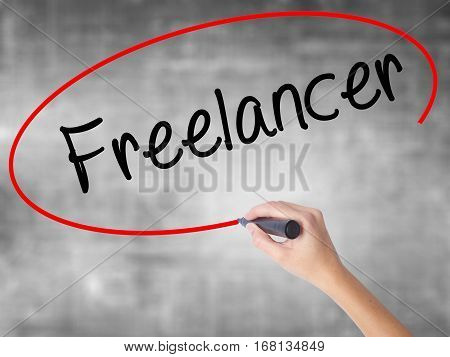 Woman Hand Writing Freelancer With Black Marker Over Transparent Board.