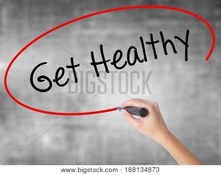 Woman Hand Writing Get Healthy With Black Marker Over Transparent Board