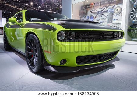 DETROIT MI/USA - JANUARY 13 2015: Sublime Green Dodge Challenger T/A Concept car at the North American International Auto Show (NAIAS) one of the most influential car shows in the world each year.