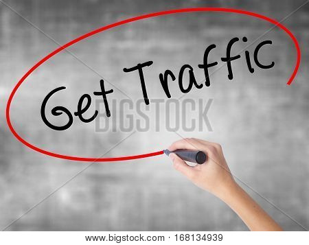 Woman Hand Writing Get Traffic With Black Marker Over Transparent Board