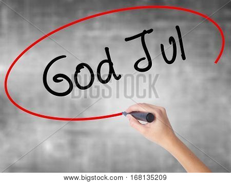 Woman Hand Writing God Jul  (merry Christmas In Swedish) With Black Marker Over Transparent Board