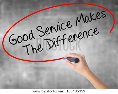 Woman Hand Writing Good Service Makes The Difference With Black Marker Over Transparent Board