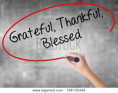 Woman Hand Writing  Grateful Thankful Blessed With Black Marker Over Transparent Board