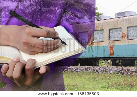 businessman with notepad hand signing documents in train repair double exposure concept .