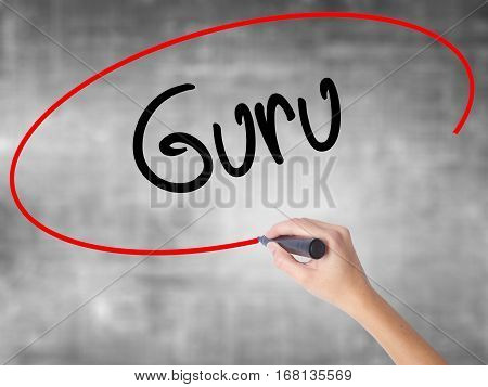 Woman Hand Writing Guru With Black Marker Over Transparent Board