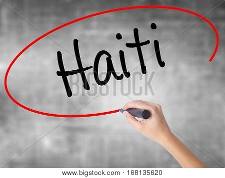 Woman Hand Writing Haiti With Black Marker Over Transparent Board