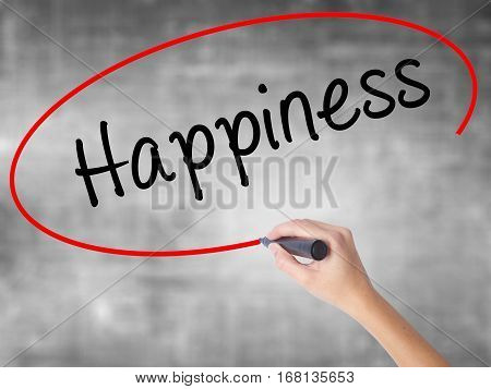 Woman Hand Writing Happiness With Black Marker Over Transparent Board