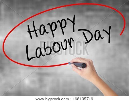 Woman Hand Writing Happy Labor Day With Black Marker Over Transparent Board