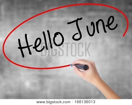 Woman Hand Writing Hello June  With Black Marker Over Transparent Board