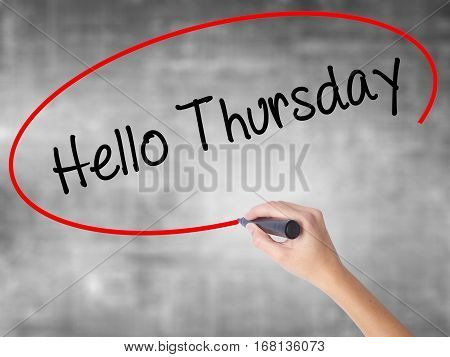 Woman Hand Writing Hello Thursday With Black Marker Over Transparent Board