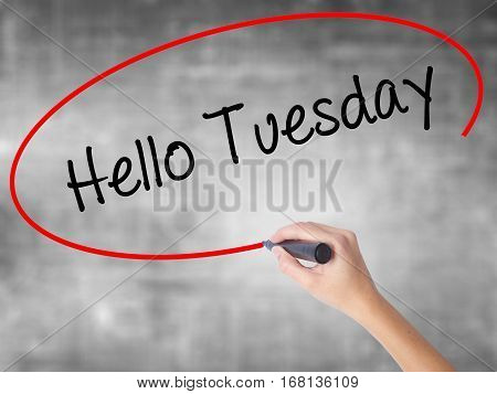Woman Hand Writing Hello Tuesday With Black Marker Over Transparent Board