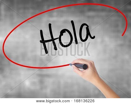 Woman Hand Writing Hola  (hello In Spanish) With Black Marker Over Transparent Board