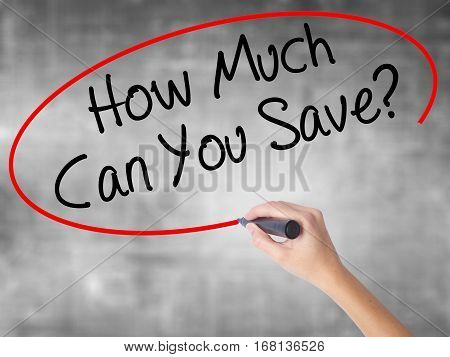 Woman Hand Writing How Much Can You Save? With Black Marker Over Transparent Board