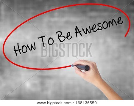 Woman Hand Writing How To Be Awesome With Black Marker Over Transparent Board