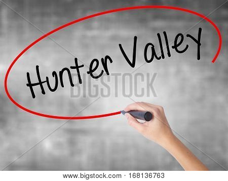Woman Hand Writing Hunter Valley  With Black Marker Over Transparent Board