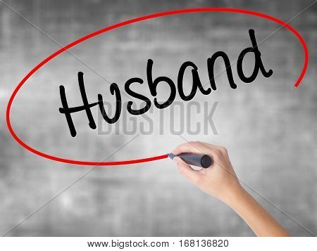 Woman Hand Writing Husband With Black Marker Over Transparent Board.