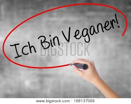 Woman Hand Writing Ich Bin Veganer! (im Vegetarian In German) With Black Marker Over Transparent Boa