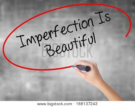 Woman Hand Writing Imperfection Is Beautiful With Black Marker Over Transparent Board