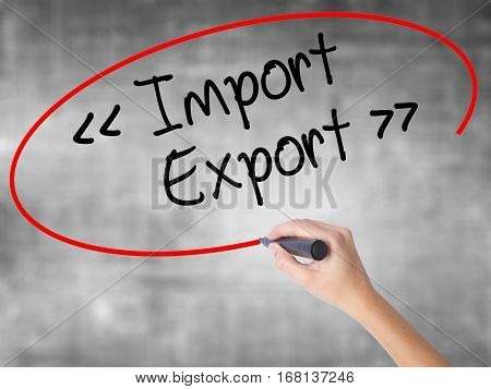 Woman Hand Writing Import - Export With Black Marker Over Transparent Board.