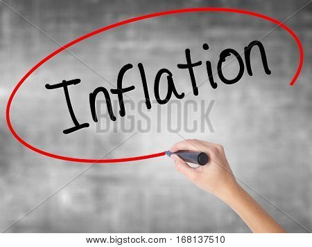Woman Hand Writing Inflation With Black Marker Over Transparent Board.