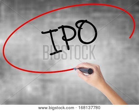 Woman Hand Writing Ipo (initial Public Offering)   With Black Marker Over Transparent Board