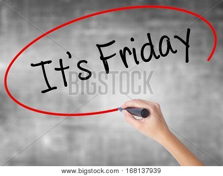 Woman Hand Writing It's Friday With Black Marker Over Transparent Board