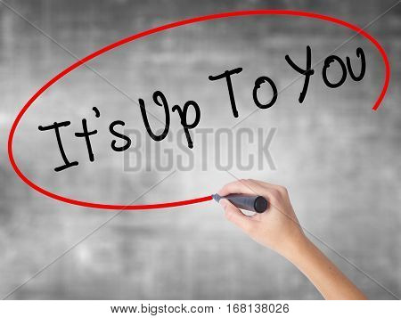 Woman Hand Writing Its Up To You With Black Marker Over Transparent Board