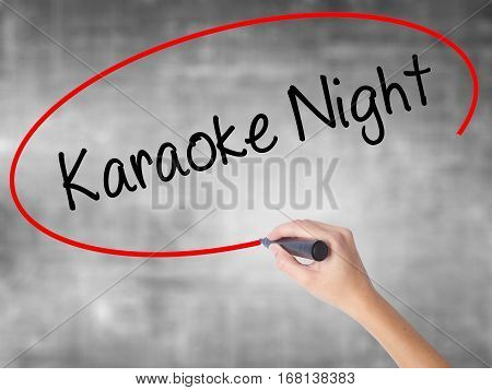Woman Hand Writing Karaoke Night With Black Marker Over Transparent Board
