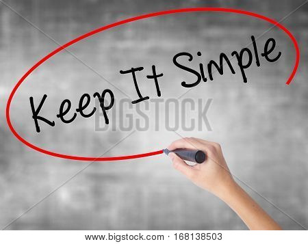 Woman Hand Writing Keep It Simple With Black Marker Over Transparent Board