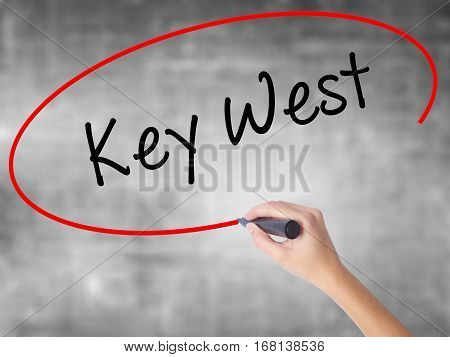 Woman Hand Writing Key West With Black Marker Over Transparent Board