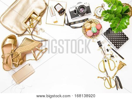 Fashion flat lay for web site social media. Feminine accessories bag shoes office supplies IPhone and green plant on white table background