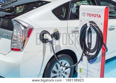 DETROIT MI/USA - JANUARY 20 2015: Toyota Prius charge port connector and cable at the North American International Auto Show (NAIAS) one of the most influential car shows in the world each year.