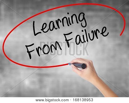 Woman Hand Writing Learning From Failure With Black Marker Over Transparent Board.