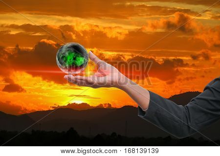 business man receiving hand holding the world in palm of idea on sky red background