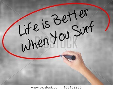 Woman Hand Writing Life Is Better When You Surf With Black Marker Over Transparent Board.