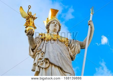 Statue of Pallas Athena in golden helmet near Parliament , Vienna, Austria
