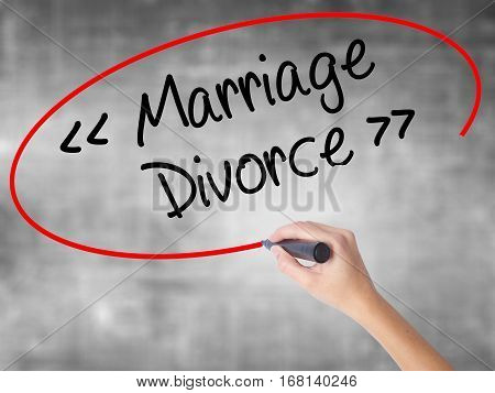 Woman Hand Writing Marriage - Divorce With Black Marker Over Transparent Board.