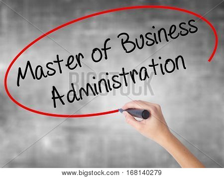 Woman Hand Writing Master Of Business Administration With Black Marker Over Transparent Board